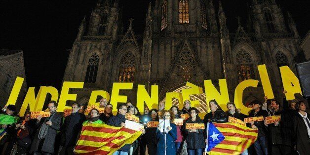 Demonstrators hold big letters forming the word 'Independence' during a demonstration called by the Catalan...