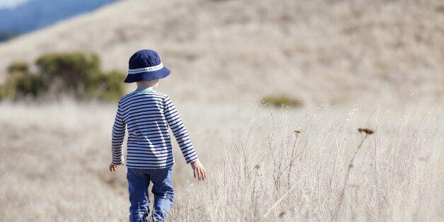 little boy enjoying beautiful weather alone