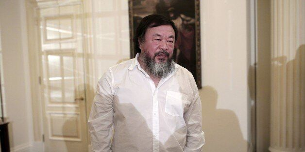 Chinese activist and artist Ai Weiwei waits before a press conference in Athens on January 1, 2016. Chinese...