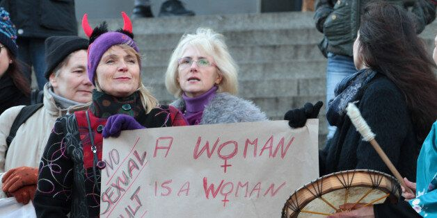 Participants of a women's flash mob demonstrate against racism and sexism in Cologne, Germany, Saturday,...