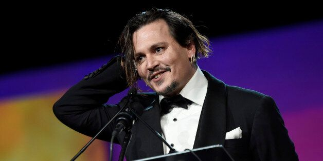 """Johnny Depp accepts the Desert Palm achievement award - actor for """"Black Mass"""" at the 27th annual..."""