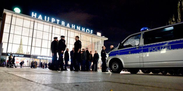 COLOGNE, GERMANY - JANUARY 09: Police stand guard in front of Hauptbahnhof main railway station after...