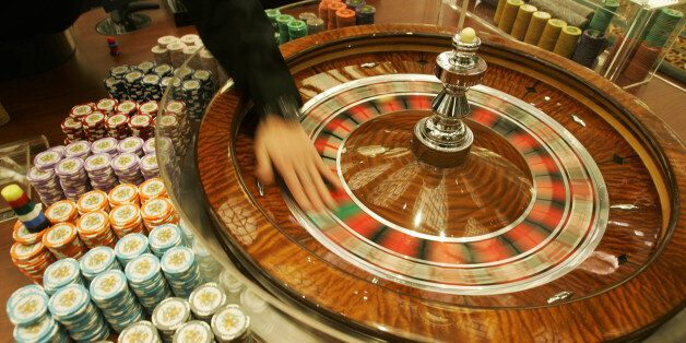 **ADVANCE FOR WEEKEND EDITIONS, MARCH 3-4** FILE ** A staff member shows photographers the gambling tables...