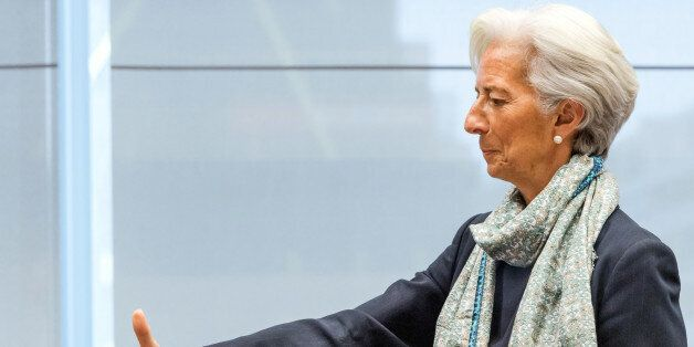 Managing Director of the International Monetary Fund Christine Lagarde reaches out to shake hands as...