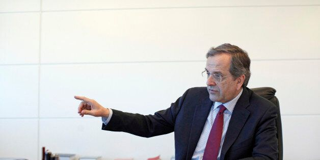 Antonis Samaras, former Greek prime minister and leader of the New Democracy party, gestures whilst speaking...