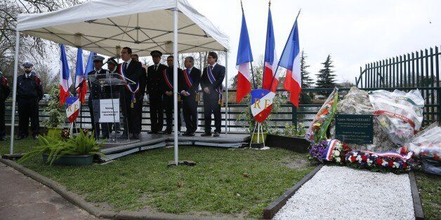 Pierre-Yves Martin (C), Mayor of Livry-Gargan, delivers a speech after unveiling a commemorative plaque...