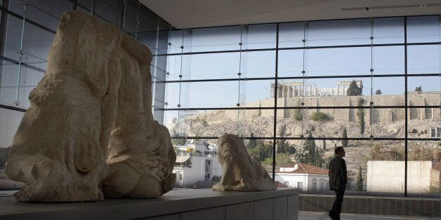 ATHENS, GREECE - OCTOBER 14: Visitors to Athens' Acropolis Museum look at the frieze of the Temple of...