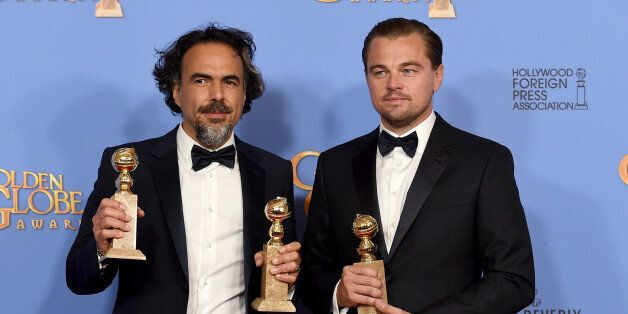 Alejandro Gonzalez Inarritu, left, and Leonardo DiCaprio pose in the press room with the award for best...