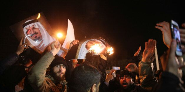 Iranian protesters gather outside the Saudi Embassy in Tehran during a demonstration against the execution...