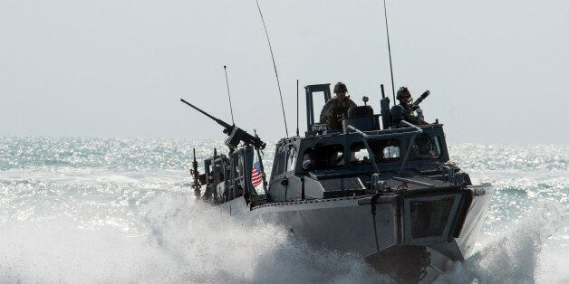 This Nov. 2, 2015, image provided by the U.S. Navy, shows Riverine Command Boat (RCB) 805 in the Persian...