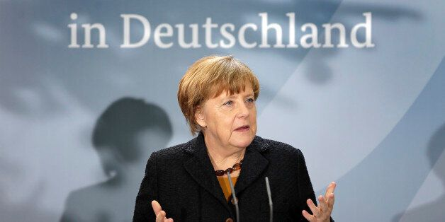 German Chancellor Angela Merkel delivers a speech during a reception at the chancellery in Berlin, Germany,...