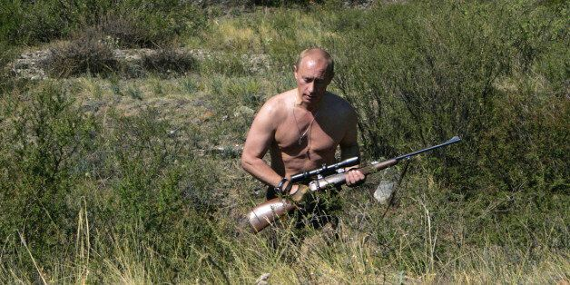 This pool picture provided 03 September 2007 shows Russian President Vladimir Putin carrying a hunting...