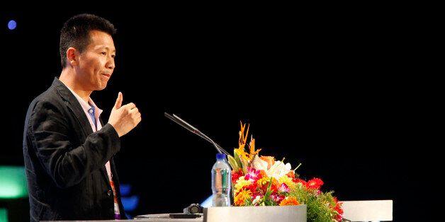 Zhou Chengjian, chairman of Metersbonwe Ltd., speaks at the 2010 Alibaba Netrepreneur Summit in Hangzhou,...
