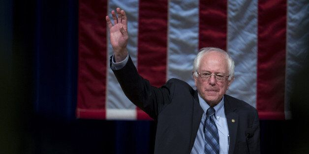 Senator Bernie Sanders, an independent from Vermont and 2016 Democratic presidential candidate, waves...