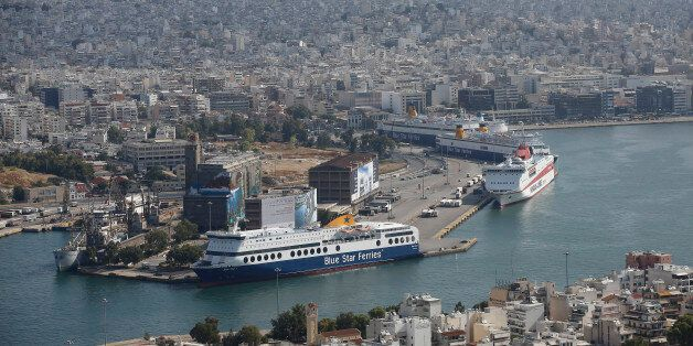 Cruise ships, operated by Blue Star Ferries Maritime SA, sit on the dockside at the commercial ferry...