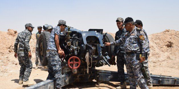 ANBAR, IRAQ - DECEMBER 23: Iraqi forces attack DAESH militants with heavy weapons at the south of Ramadi,...