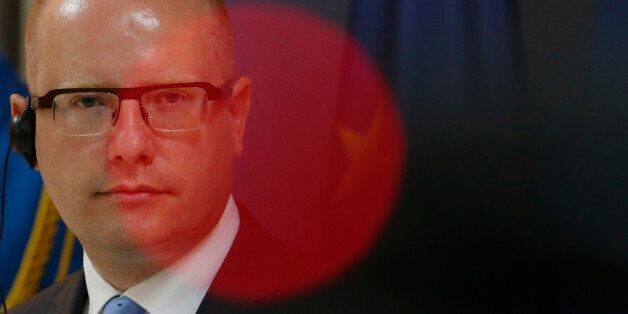 Czech Prime Minister Bohuslav Sobotka listens questions during a press conference after talks with his...