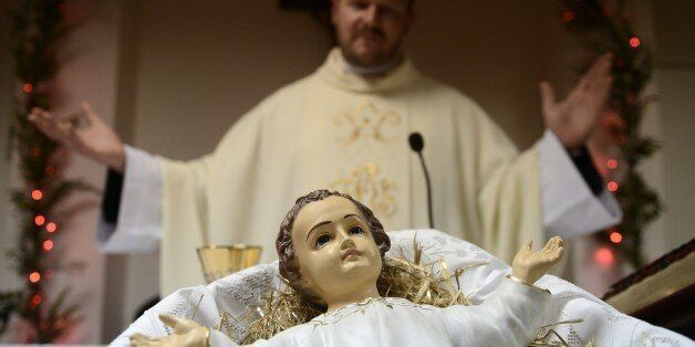 IZMIR, TURKEY - DECEMBER 24: Priest Maciej Sokolowski (C) leads a mass during Christmas Eve, marking...