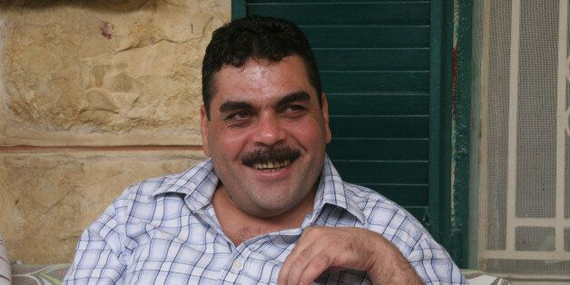 Samir Kuntar greets visitors on July 19, 2008, at his family home in Aabey, Lebanon. Kuntar spent nearly...