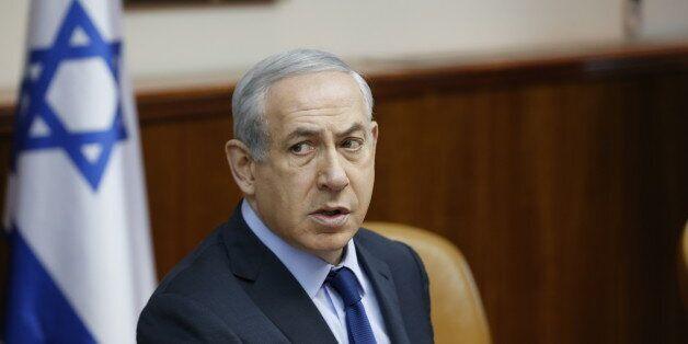 Israel's Prime Minister Benjamin Netanyahu, center, speaks during the weekly cabinet meeting in Jerusalem,...