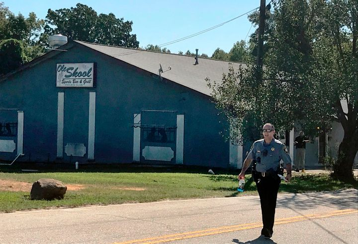 A Lancaster County Sheriff's deputy walks around the Old Skool Sports Bar and Grill, the scene of a shooting early in the mor