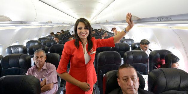 NEW DELHI,INDIA MAY 20: Air Hostess inside the Aeroplane during the launch of Air Asia flight at IGI...