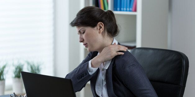 Businesswoman leading sedentary lifestyle causing back
