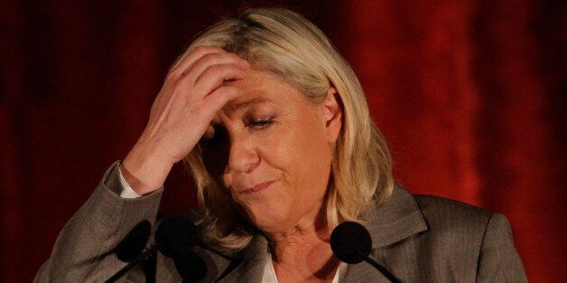 French far right National Front party leader Marine Le Pen gestures as she delivers a speech during a...