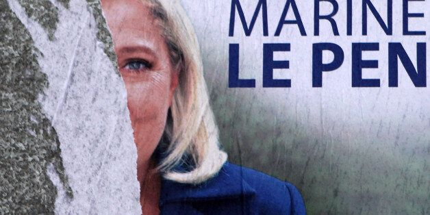 A torn poster of French far-right party leader Marine Le Pen is seen in Henin-Beaumont, northern France,...