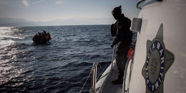 Members of the Frontex, European Border Protection Agency, from Portugal approach a dingy with 56 people,...