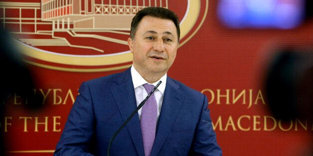 Macedonian Prime Minister and leader of the VMRO-DPMNE conservative party Nikola Gruevski talks to the...