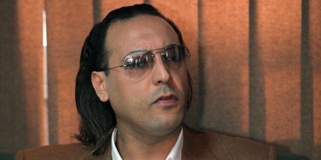 The son of Libayan leader Moamer Kadhafi, Hannibal, speaks to jailed Swiss businessman Max Goeldi during...