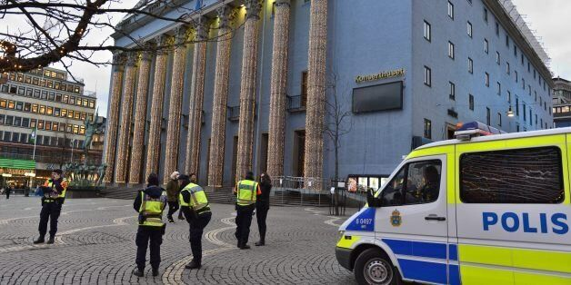 Police guard the cleared Haymarket Square, usually bustling with market stalls, in front of Stockholm...