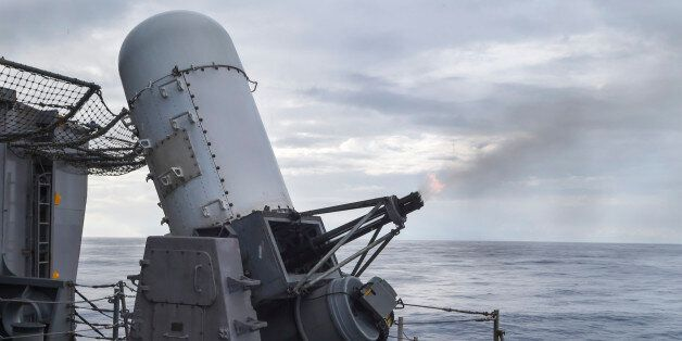 SOUTH CHINA SEA (Oct. 8, 2014) The close-in weapon system (CIWS) fires 20mm rounds during detect-to-engage...