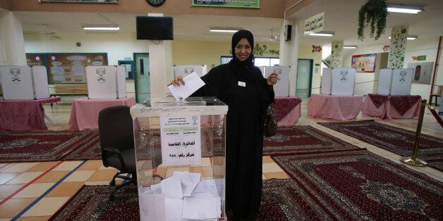 JEDDAH, SAUDI ARABIA- DECEMBER 12: A Saudi woman casts her vote for the municipal elections at a polling...