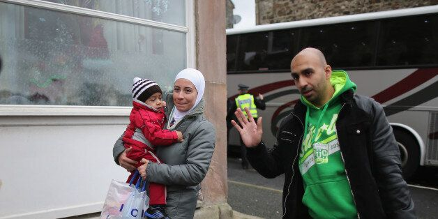ROTHESAY, ISLE OF BUTE, SCOTLAND - DECEMBER 04: Syrian refugee families arrive at their new homes on...
