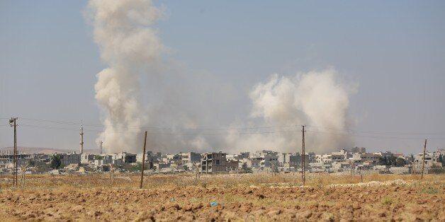 SANLIURFA, TURKEY - JUNE 27: A view of the Syrian border town of Kobani (Ayn al-Arab) from the borderline...