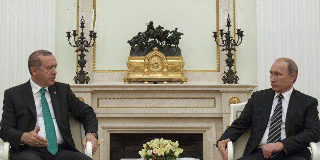 MOSCOW, RUSSIA - SEPTEMBER 23: Turkey's President Recep Tayyip Erdogan (L) meets Russian President Vladimir...