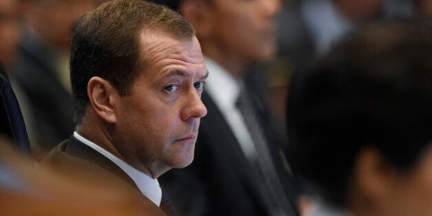 Russia's Prime Minister Dmitry Medvedev, sitting next to President Barack Obama, attends the East Asia...