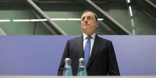 Mario Draghi, president of the European Central Bank (ECB), pauses before taking his seat for a news...