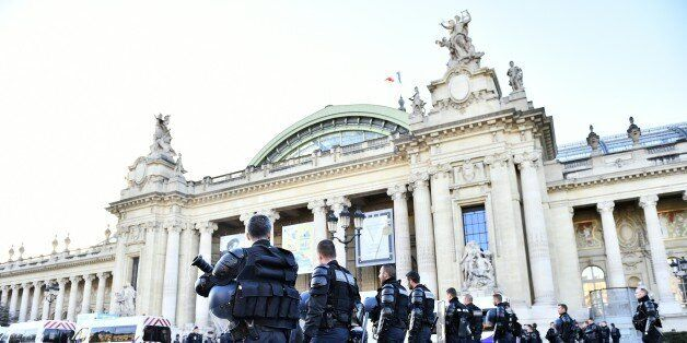 French police forces stand in front of the 'Solutions COP21' exhibition at the Grand Palais in Paris...