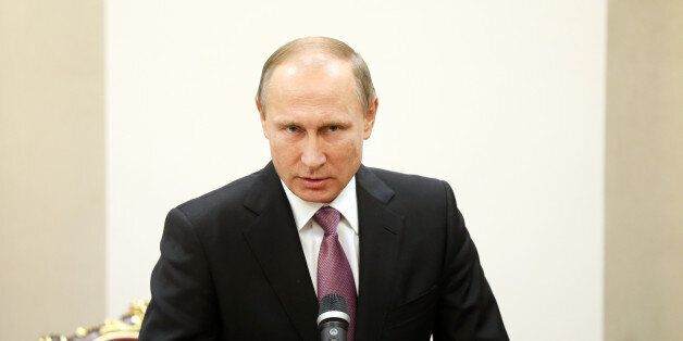 Russian President Vladimir Putin speaks with media in a joint press conference with his Iranian counterpart...