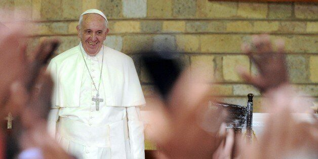 Pope Francis smiles at the Church of Saint Joseph the worker in the Nairobi shanty town of Kangemi before...