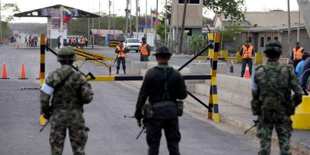 Colombian police officers and soldiers patrol the border between Colombia and Venezuela, in Paraguachon,...