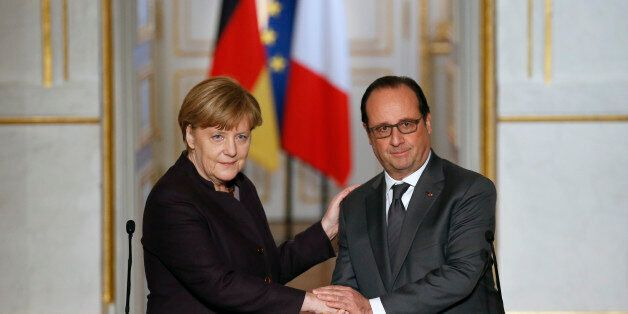 French president Francois Hollande, right shakes hands with German Chancellor Angela Merkel at the end...
