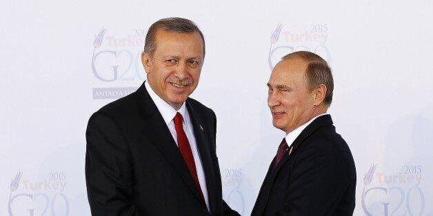ANTALYA, TURKEY - NOVEMBER 15 : Turkish President Recep Tayyip Erdogan (L) greets Russian President Vladimir...
