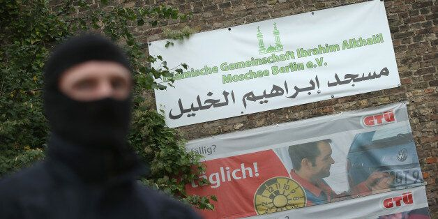 BERLIN, GERMANY - SEPTEMBER 22: A masked policeman stands outside the Ibrahim Alkhalil mosque following...
