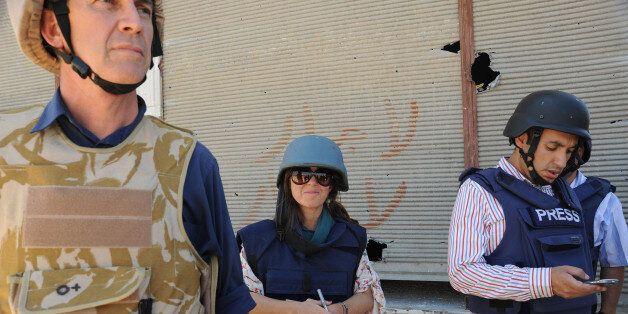 HOULA, SYRIA - 27 MAY 2012: Alex Thomson (L) chief international correspondent for British Channel 4...