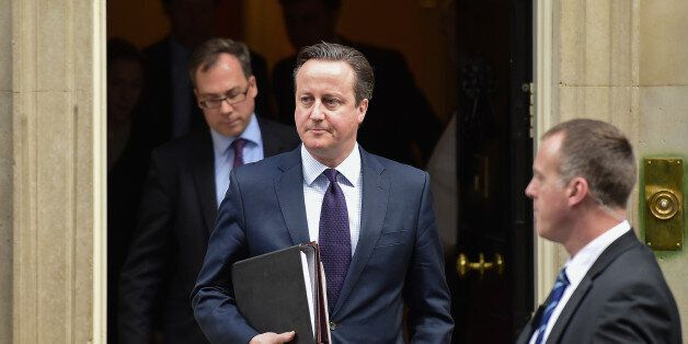 British Prime Minister David Cameron (C) leaves 10 Downing Street in central London on November 26, 2015,...