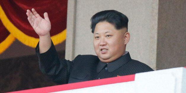 North Korean leader Kim Jong Un waves at a parade in Pyongyang, North Korea, Saturday, Oct. 10, 2015....